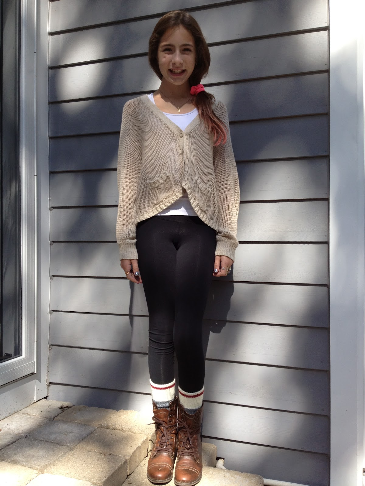 sweater with black brown boots and dress dress